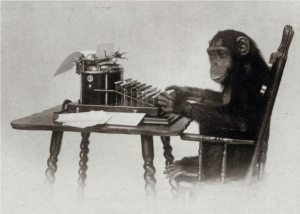 a monkey sitting at a typewriter, tapping on keys